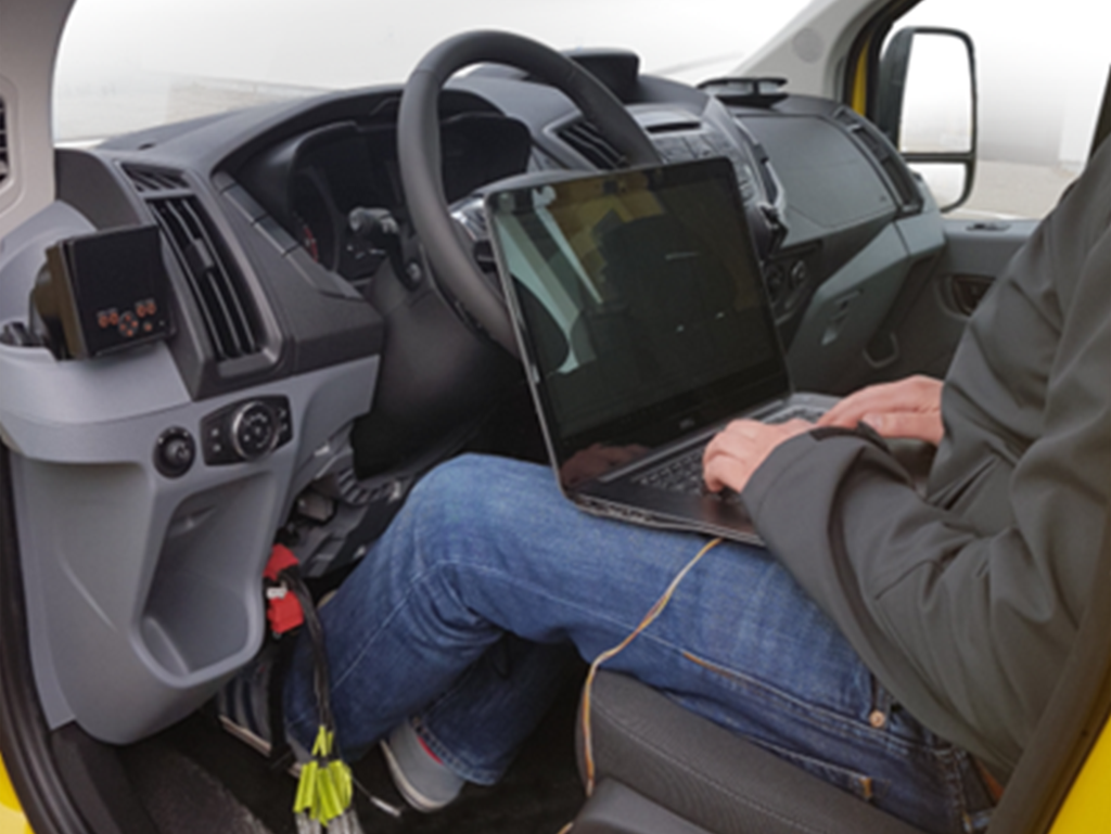 developer sitting in a vehicle